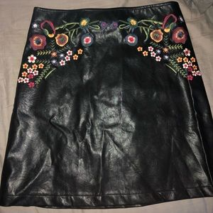 Black leather skirt with floral detailing